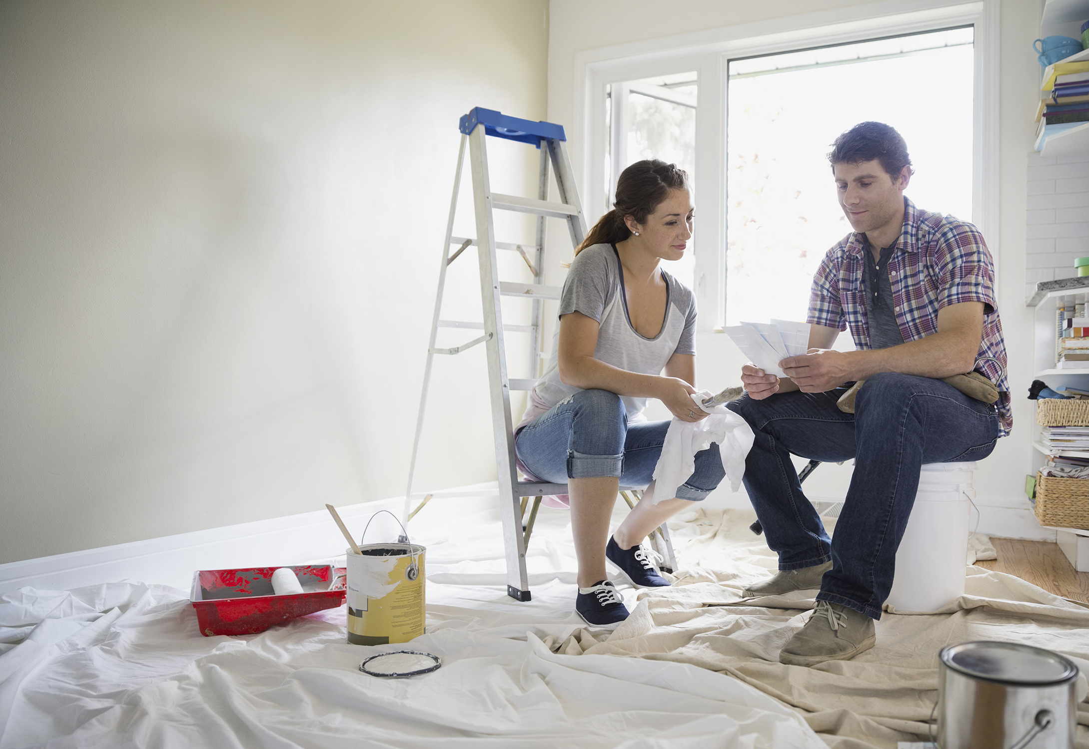 Couple discussing an Alliant home equity loan in home
