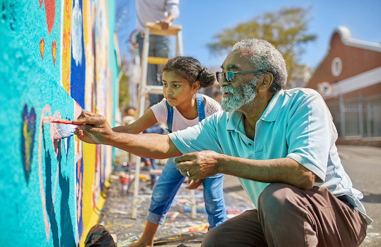 Grandfather and granddaughter volunteering for charity